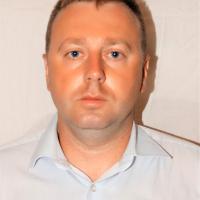 Александр Комов